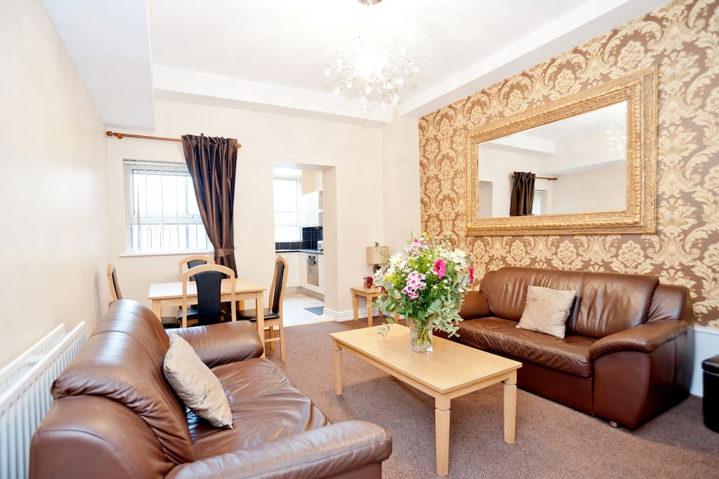 With enough space to fit a dozen people, this apartment also has two double sofa beds.