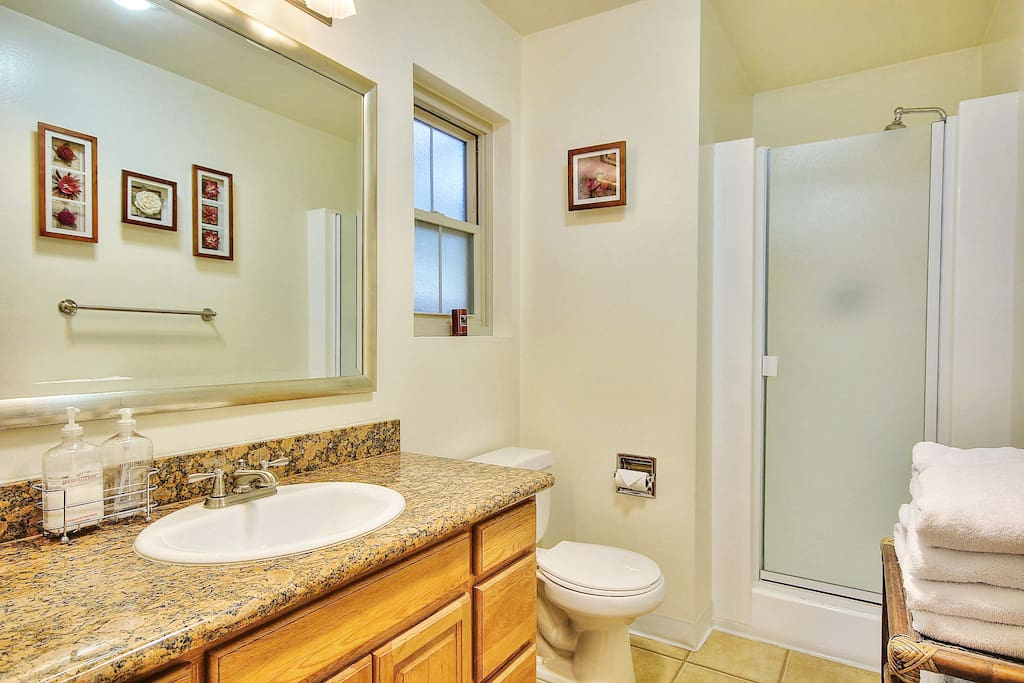 Large private bathroom with shower. Granite counter tops. Clean and ample luxury linens. Several drawers for storage.