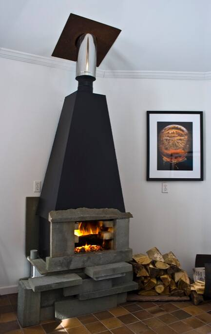 Stone and Steel fireplace. Keeps things cozy warm.