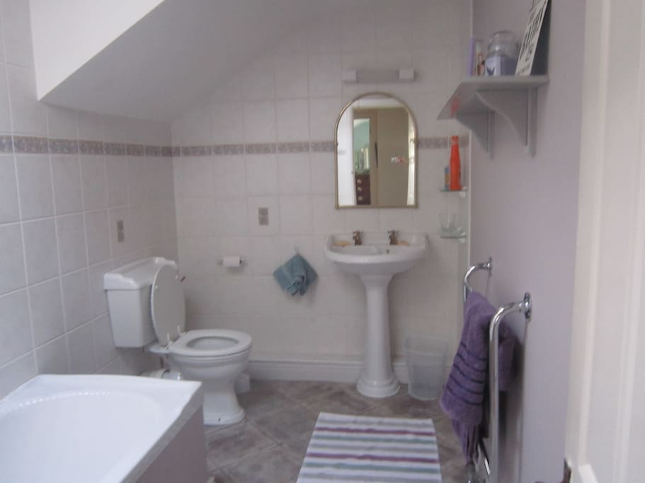 Your private bathroom with full bath and power-shower.