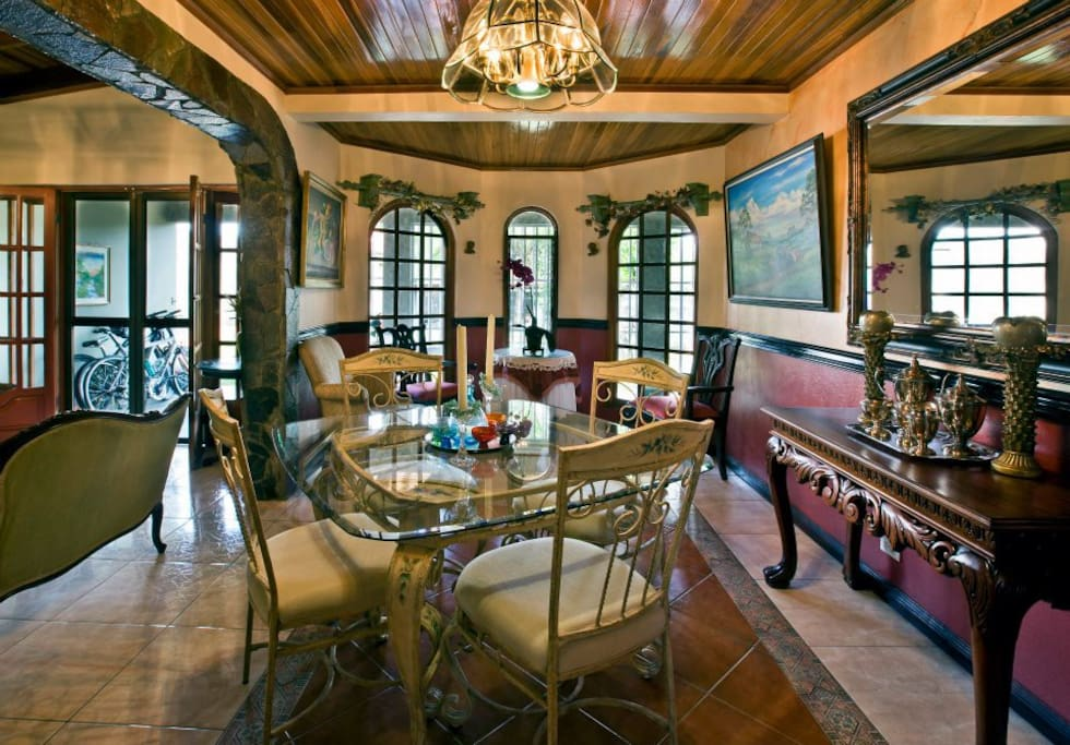 Dinning room has been renovated with wooden table and accommodates 6.