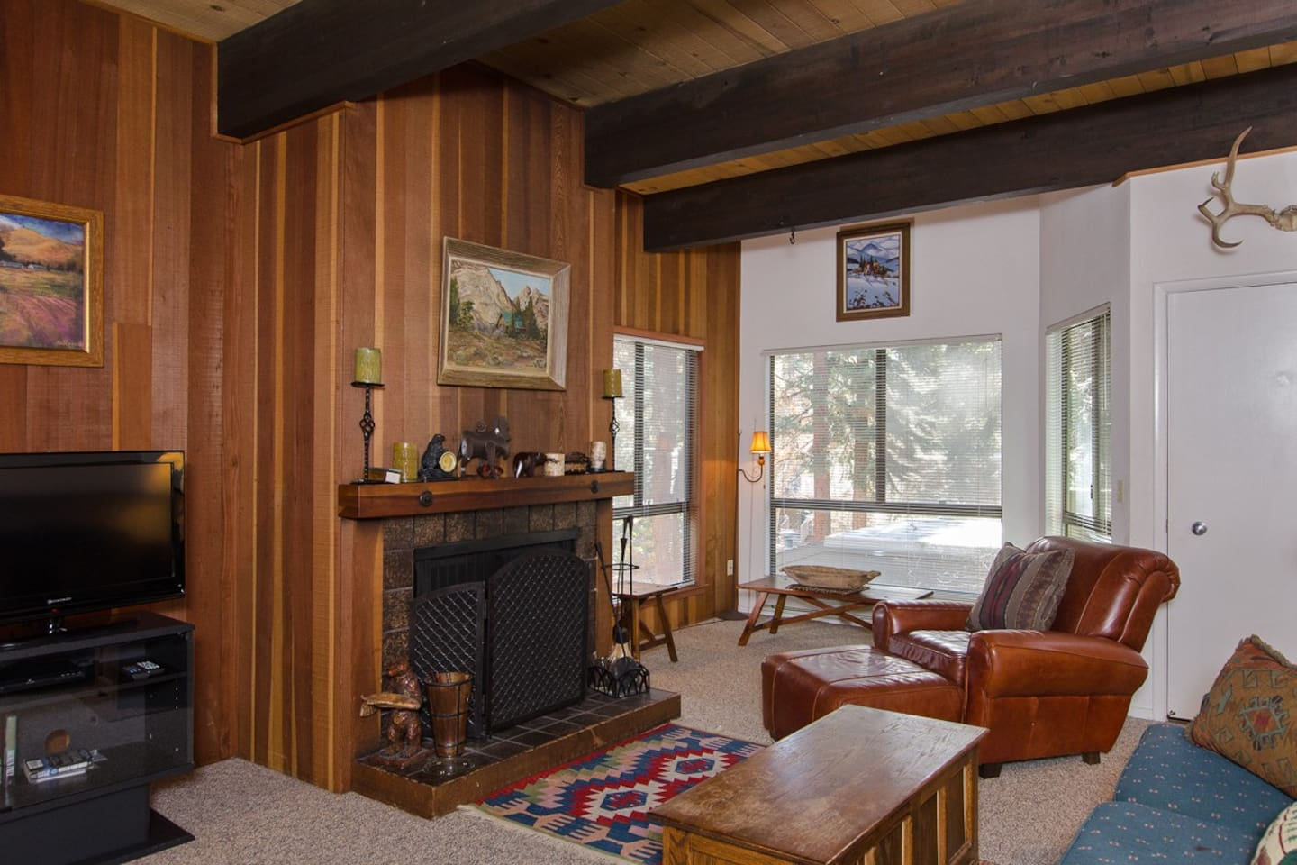 LIVING ROOM UPSTAIRS WITH FIREPLACE AND BEAM CEILINGS
