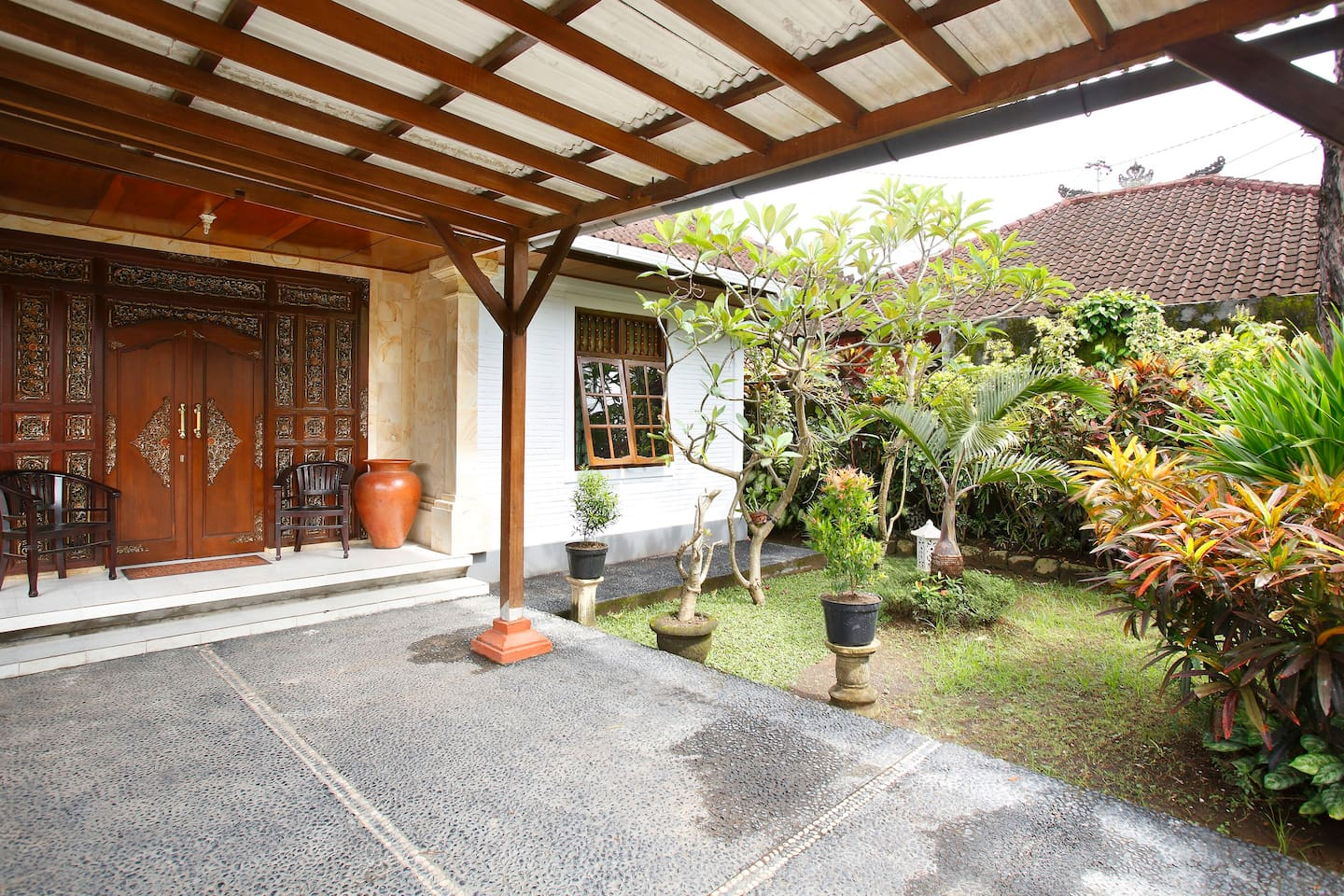 traditional Balinese villa surrounded by beautiful gardens
