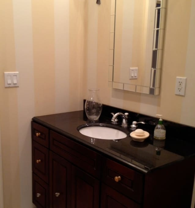Two newly renovated bathrooms, marble tile, large showers, and the original claw foot tub.