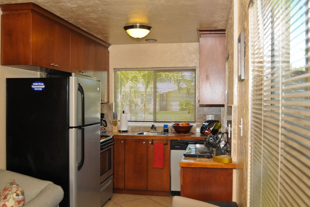 Kitchen has all appliances,coffee maker, pots, pans dishes and  glassware.