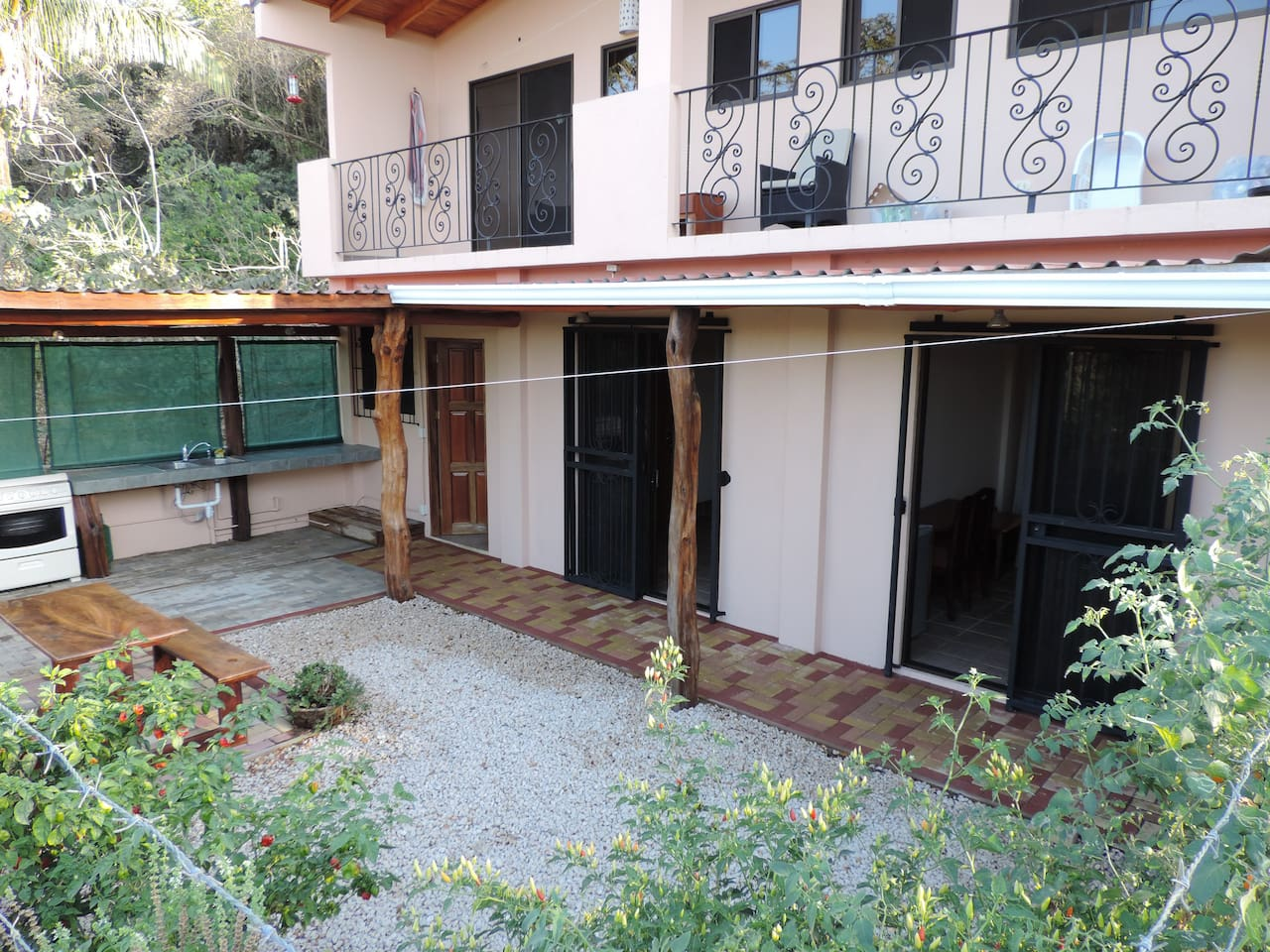 2-195 square foot (18 square meters) apartments with separate baths share this Courtyard and outdoor Kitchen.