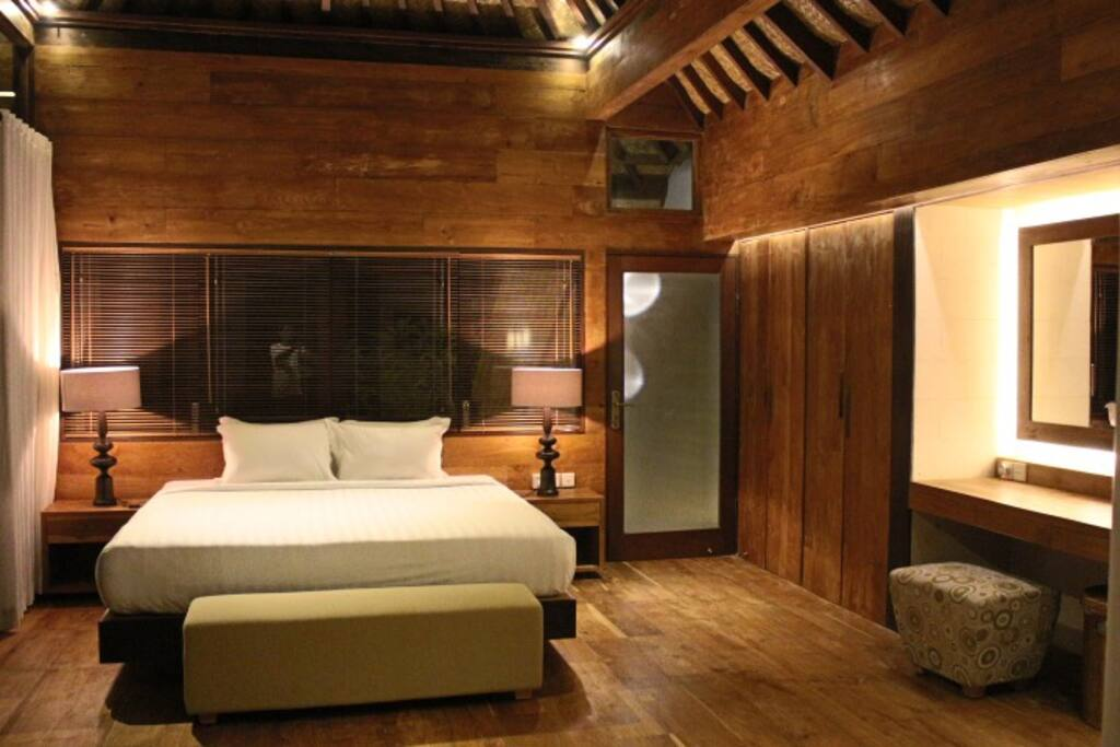 One of our master bedrooms with old teak wood finishings, floors and walls.