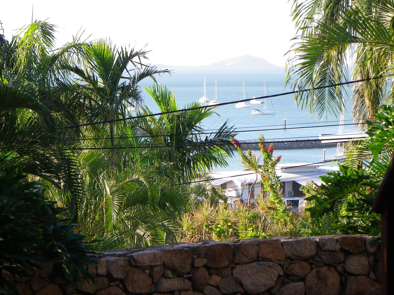 Wake up to this beautiful view!  Only a short walk to Abel Point Marina, the Main street or Port of Airlie, for all your day trips to the Whitsunday Islands, Great Barrier Reef and snorkeling adventures!