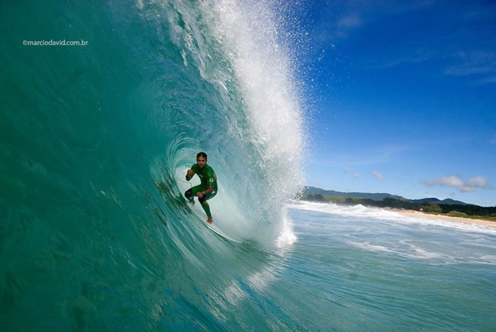 5 nights get a free surf lesson,with professional surfer photo Marco Polo.
