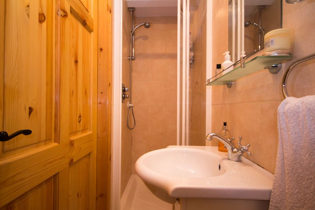 Guests have sole use of a modern clean shower room with strong shower + wash-hand-basin + wc. This is situated right across the hall from the guest bedroom.