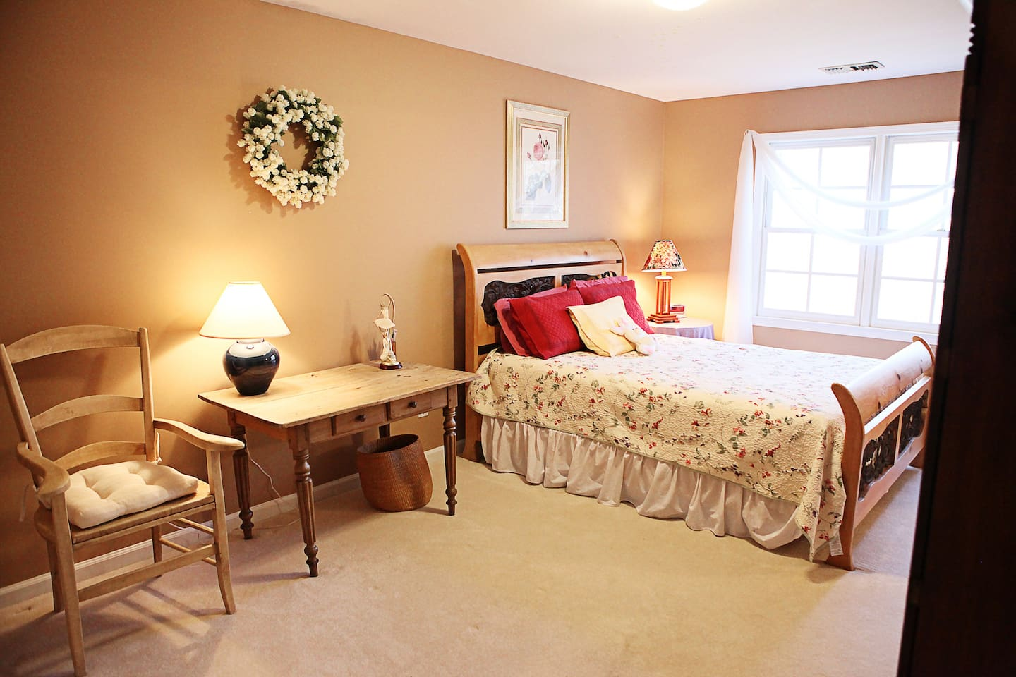 Comfortable bed in well-lit room with desk, and walk-in closet. Twin-sized  canopy bed, and lovely view of the flowing stream below.