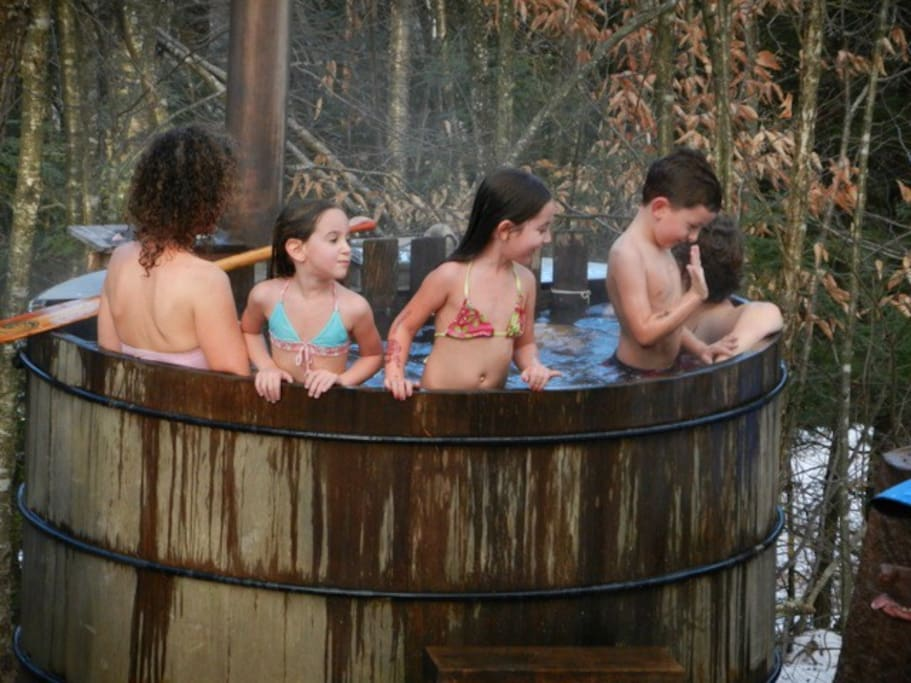 Dec. 29, 2011 there's snow on the ground and the children are outdoors in bathing suits!