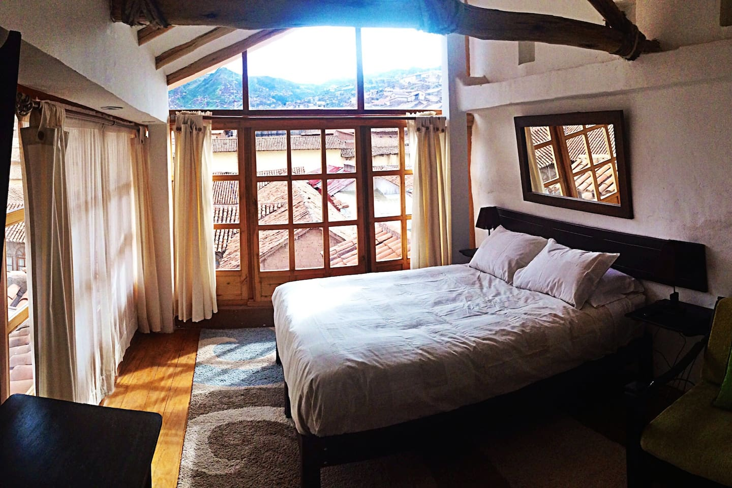 1Queen Bed Deluxe Private Ensuite with a view of the city and the mountains.