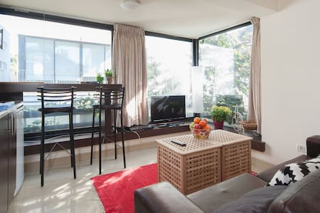 Central sunny Allenby apartment