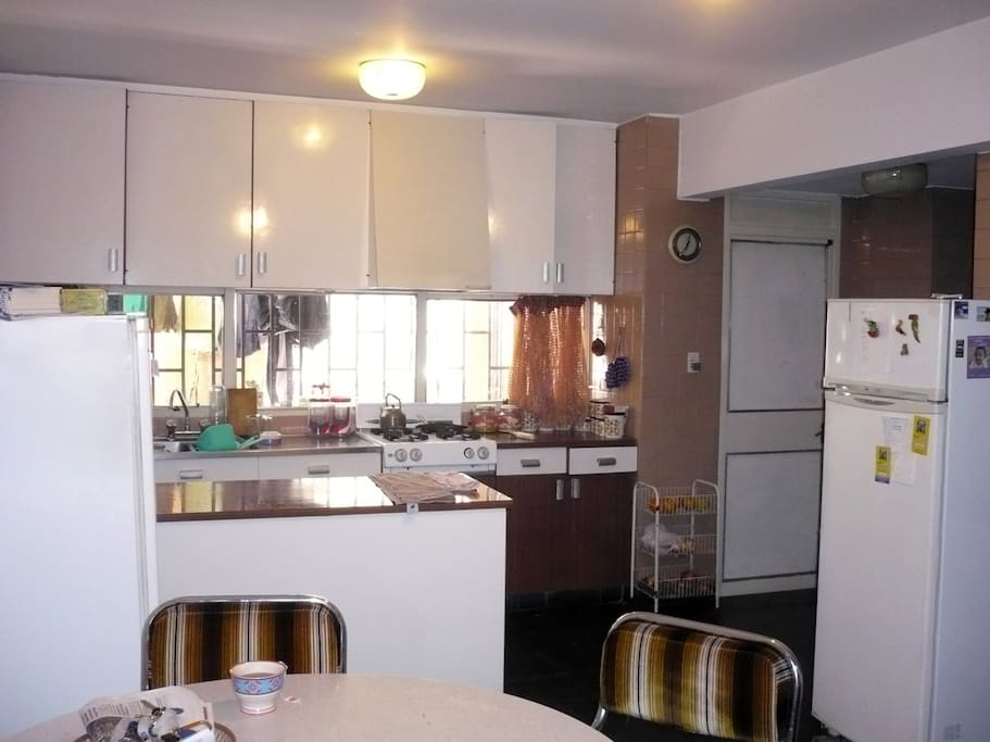 Enough fridge place for everybody. The dinning room and kitchen are spacious.