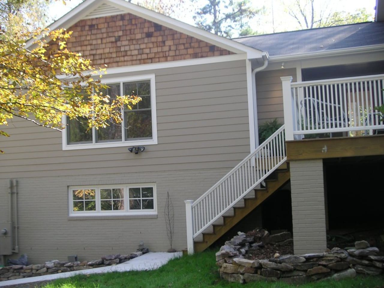 Large picture windows overlook wooded front yard. Park your car right at your entry steps.