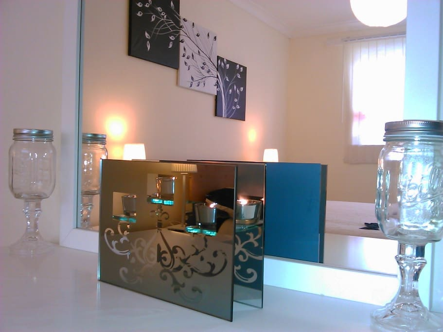 A reflective shot through the dressing table mirror capturing beautiful candle holder.