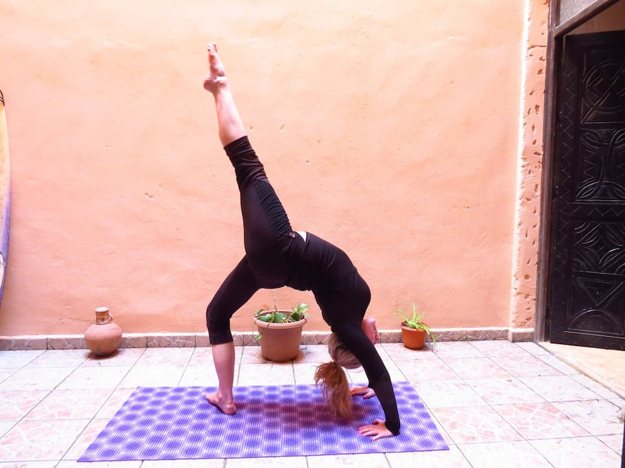 Yoga in the courtyard of the ground floor apartment