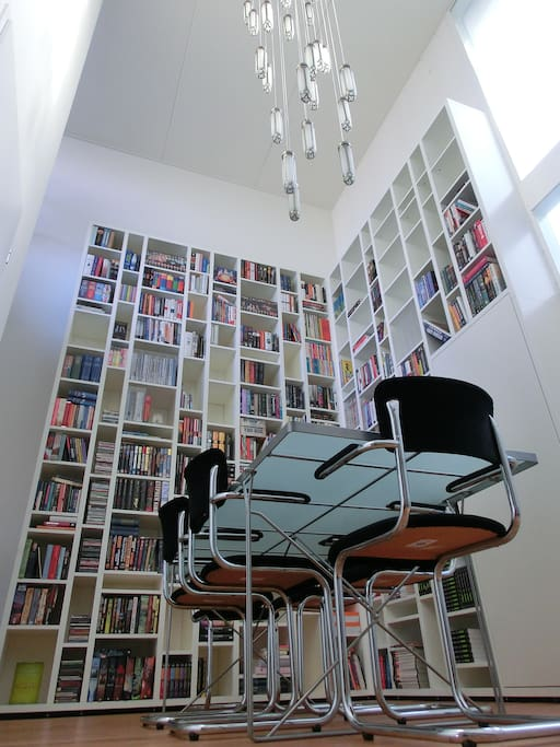 Entry hallway, 6 meters high, with 4-meters book case