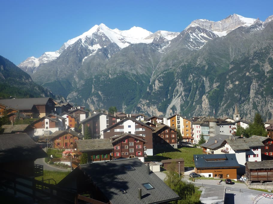View to the village of Grächen and snowy mountains