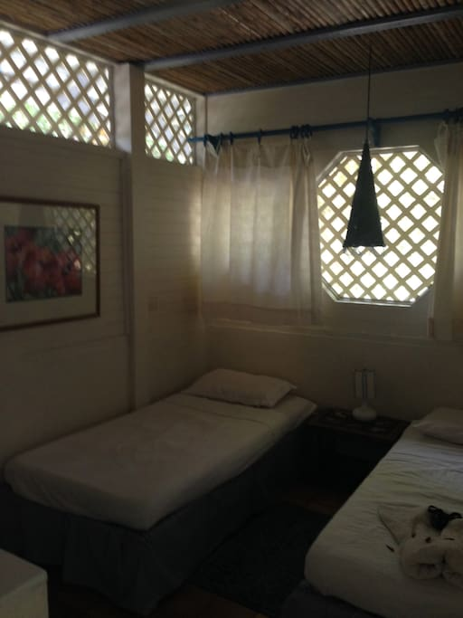 1 of the 3 rooms ( each with 2 single beds)