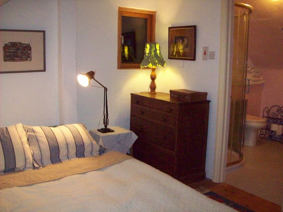 Double Bed with en suite shower room and toilet.