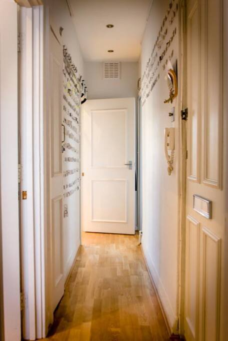Hallway leading to kitchen and bathroom. Entry on right.
