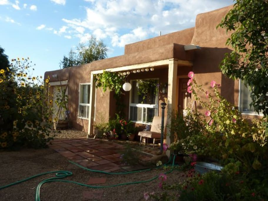 Street side of house. Convenient side-street location, plenty of parking, 1.8 miles from middle of historic Taos.