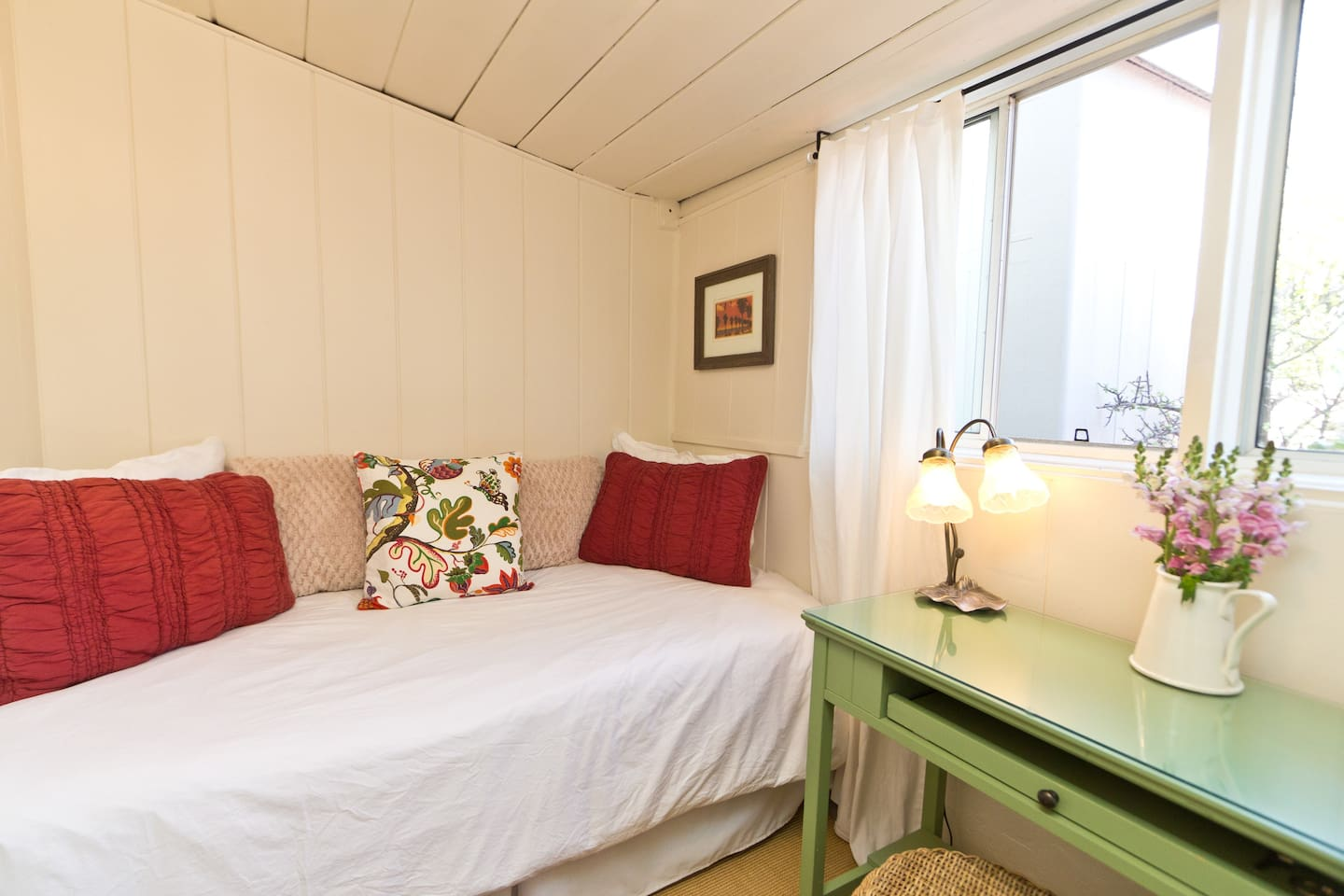 Comfortable twin bed and workspace.