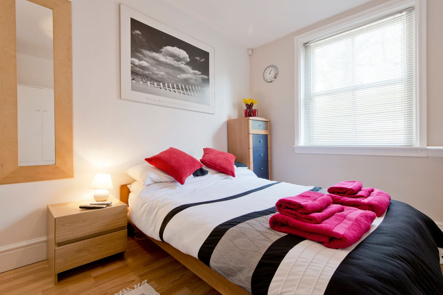 Clean, comfortable and contemporary double room showing dining area