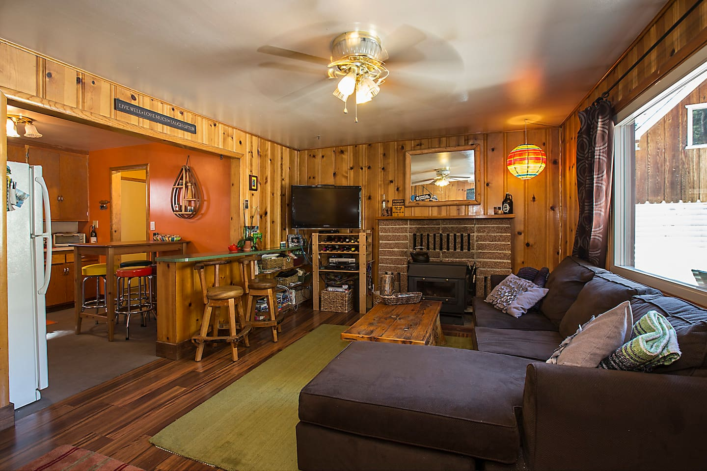 Living room with TV, Wii, wood burning stove.