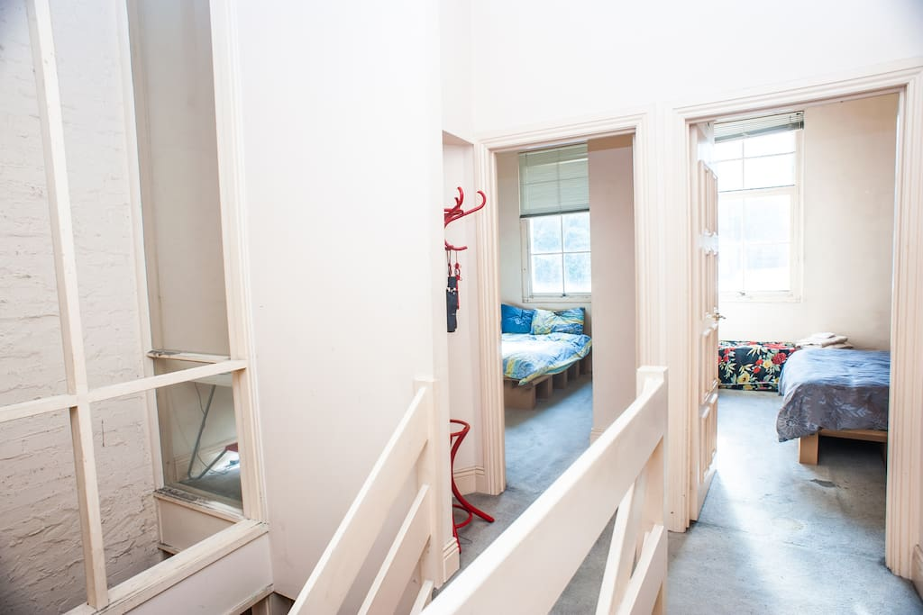 Upstairs landing: Bedroom #1 on the left, Bedroom # 2 (book via http://www.airbnb.com/rooms/307630) on the right, guest bathroom to right of frame