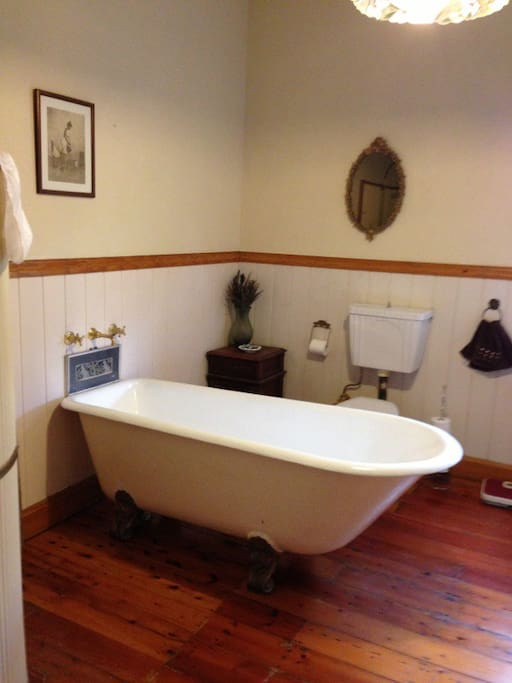 beautiful main bathroom featuring clawfoot bath