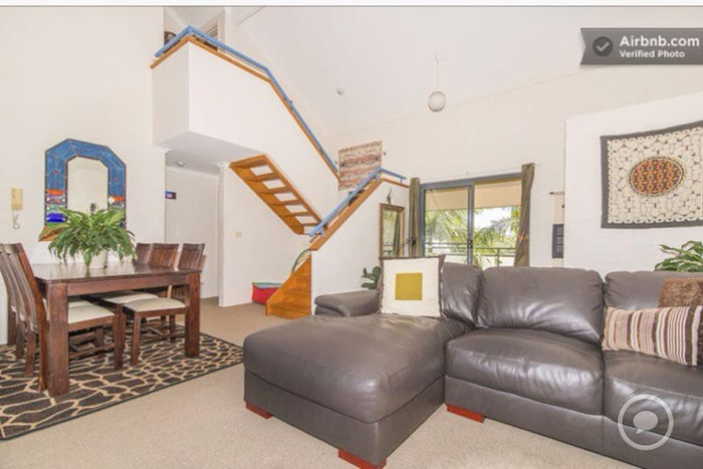 The apartment consists of open-plan living, high cathedral ceilings, and balconies on either end facing east and west to ensure maximum airflow.