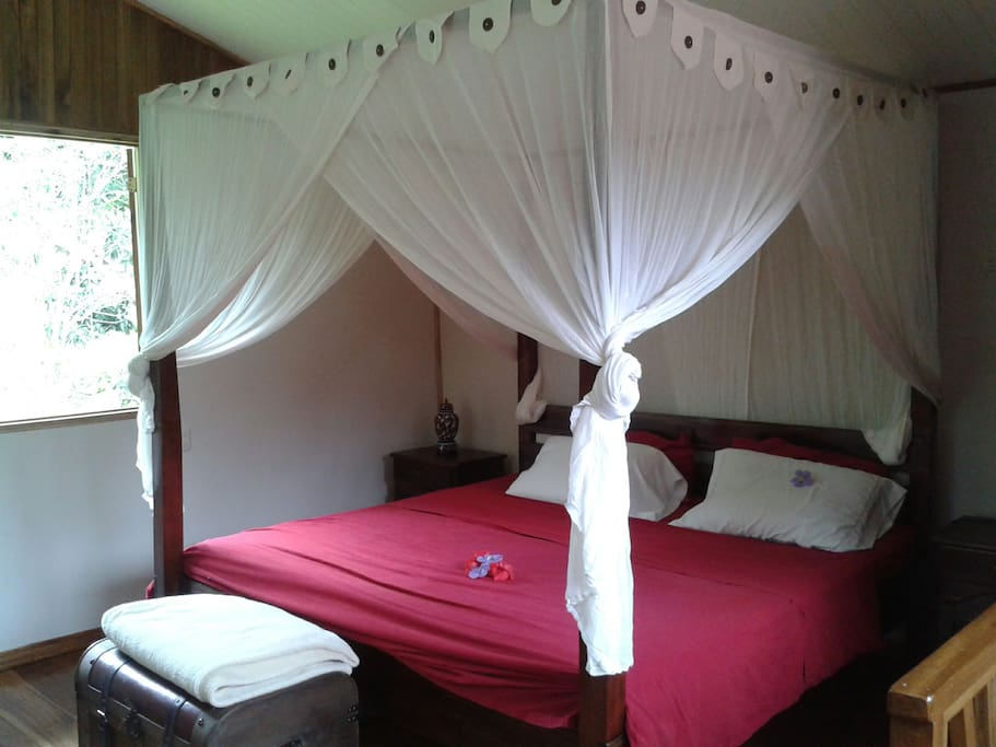 king size bed with sealing fan an mosquito netting