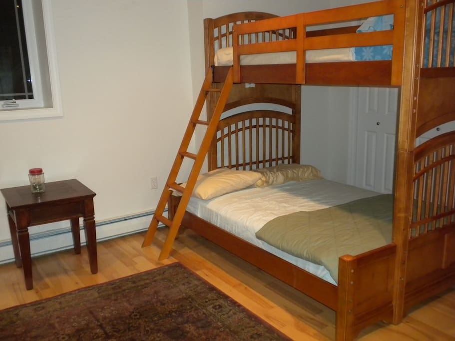Bunkroom located on lower level has twin over full-sized beds.
