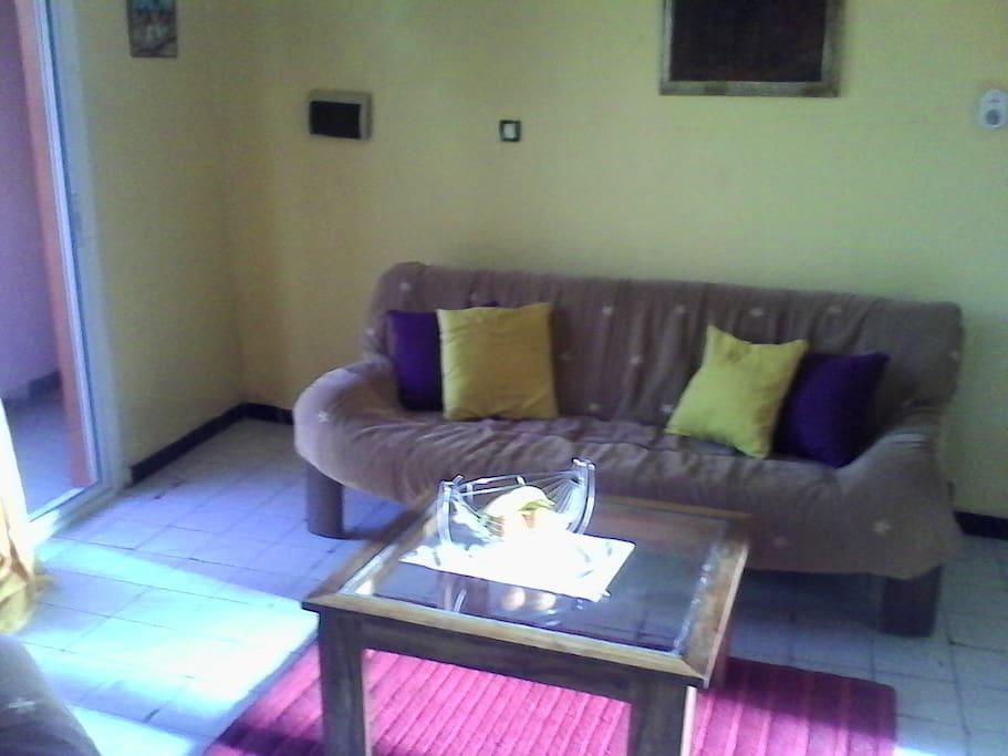BRight spacious living area with balcony and mini fridge