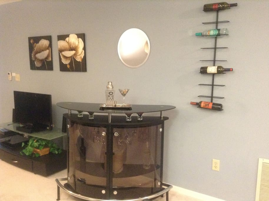 Stock the bar and enjoy the entertainment center!