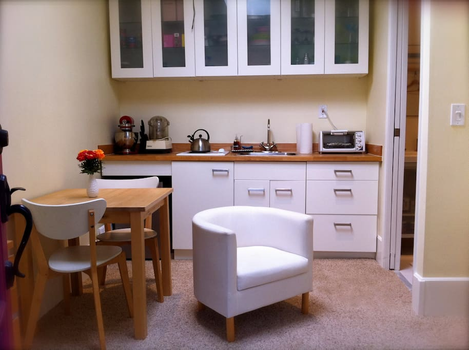 The casita features a great little kitchenette with stove top, mini-fridge, toaster oven, microwave, coffee maker, and glasses, plates, flatware, pots & pans. (There is space to hang clothes, but no wardrobe or closet.)