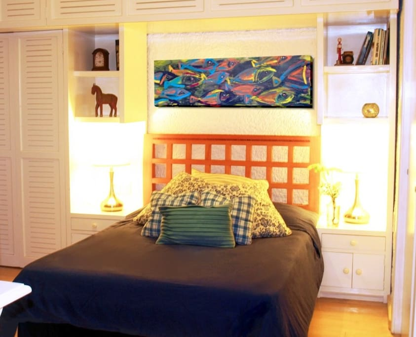 Bedroom with lots of storage areas