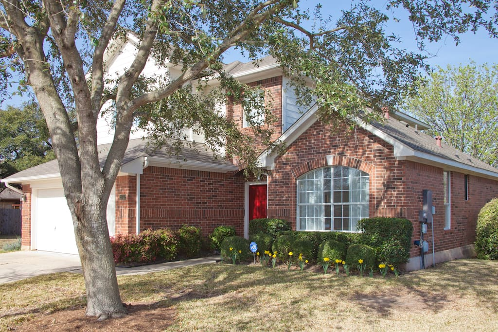 Pleasant and inviting curb appeal with beautiful live oak tree.