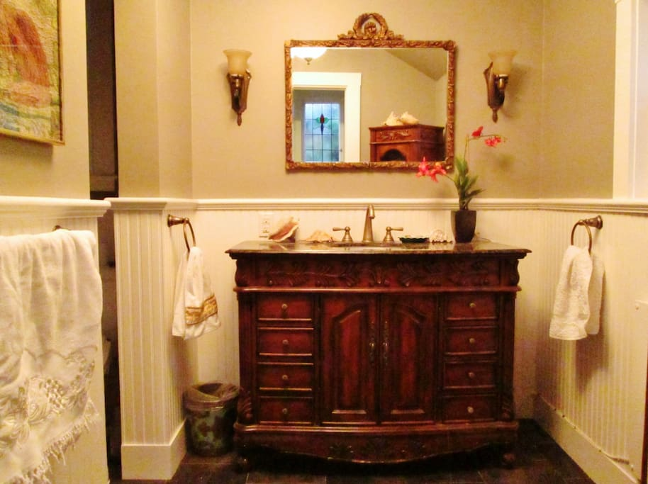 Remodeled bathroom with granite topped vanity