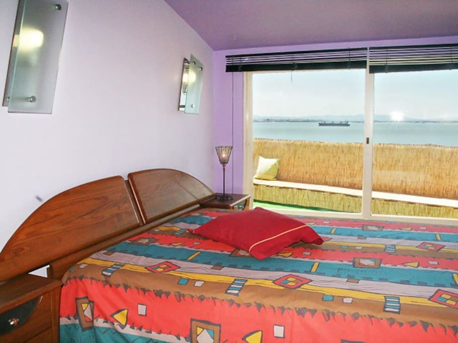 Double room with river view and blind curtains