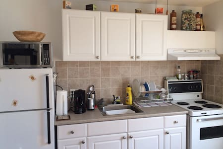 """Bright & beautiful room sharing a clean washroom and kitchen with one person who is never home in a 2 bedroom 2nd floor Apmt. 30 secs to dufferin subway. 15 min to downtown core. Completely furnished top to bottom! Bed linen, towels, soap, shampoo, conditioner, Wifi, greatbellcable, 32"""" HDTV."""