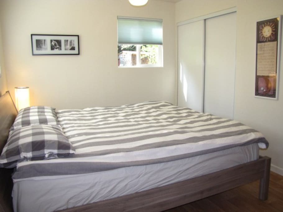 Comfortable king size bed with pillow top mattress.