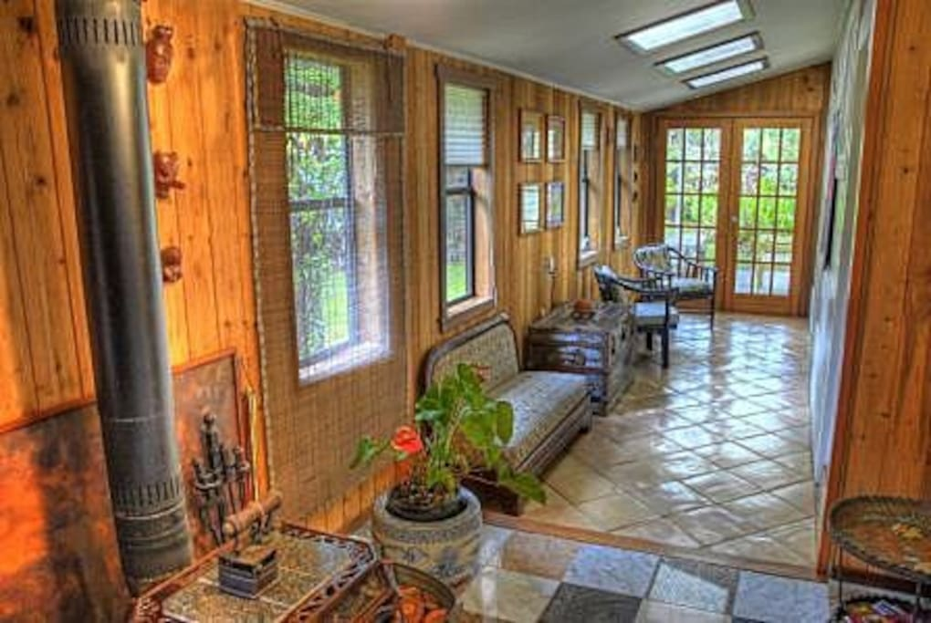 The hallway / sitting area, with back doors to the patio.
