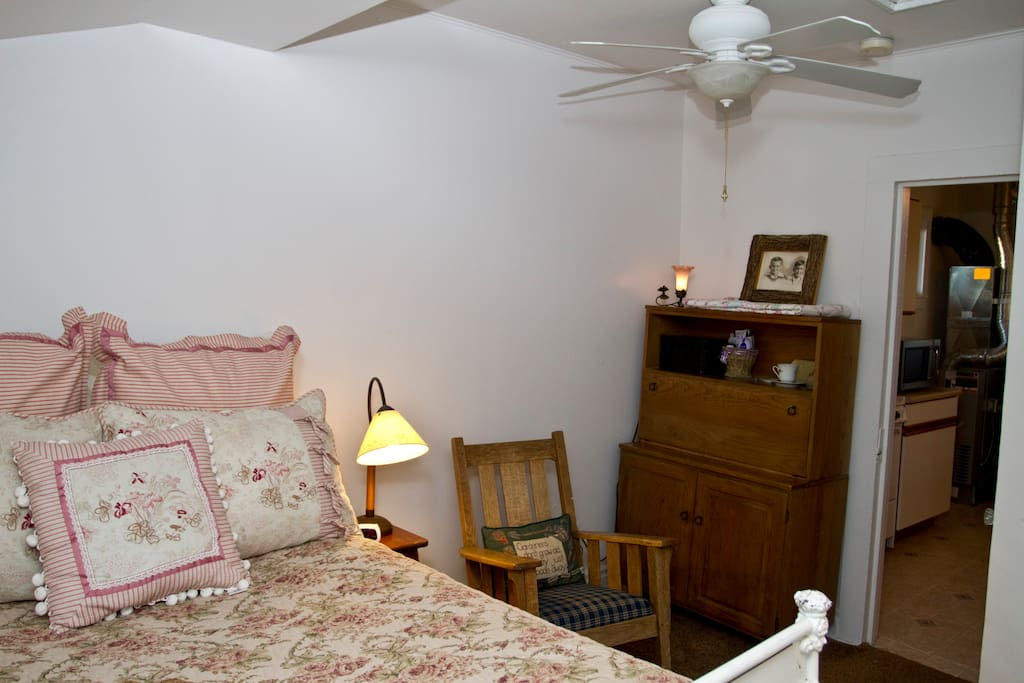 The cottage is decorated with vintage family furniture.