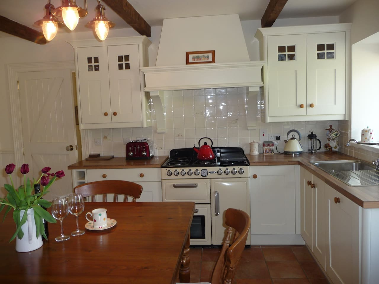 Kitchen with large range cooker and family dining table