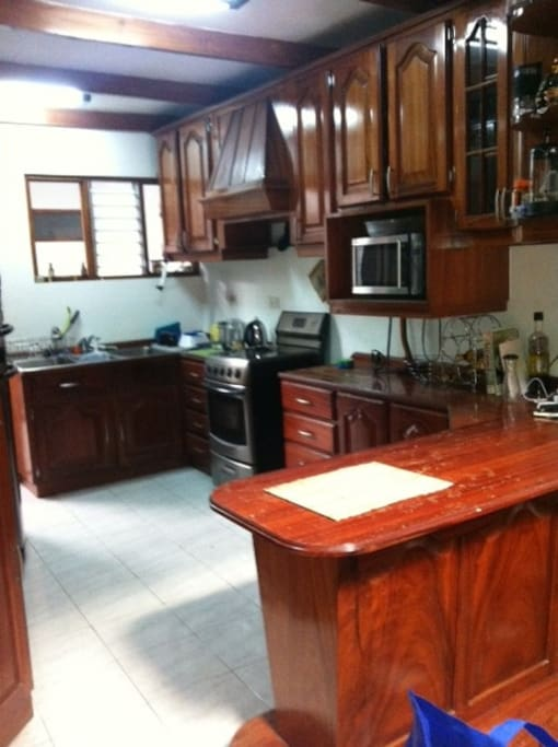 Fully equipped kitchen.  Counter to have your meals/coffee.