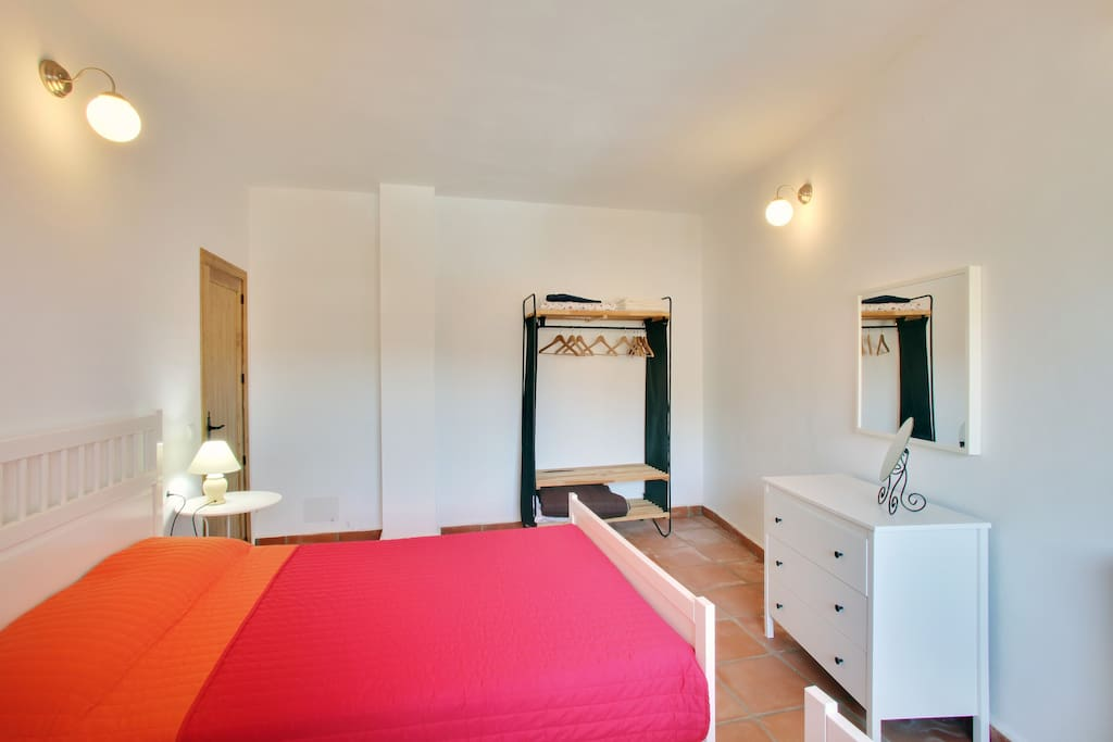 Bedroom with one double and one single bed.